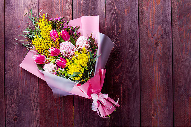 bouquet with tulips and Mimosa on a wooden table. place for text